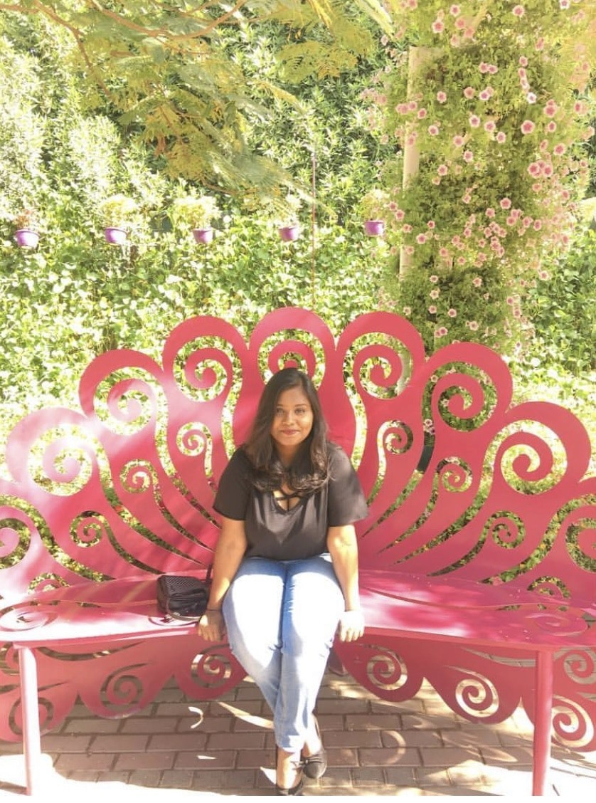 A picture depicting payal sinha, seated on a chair